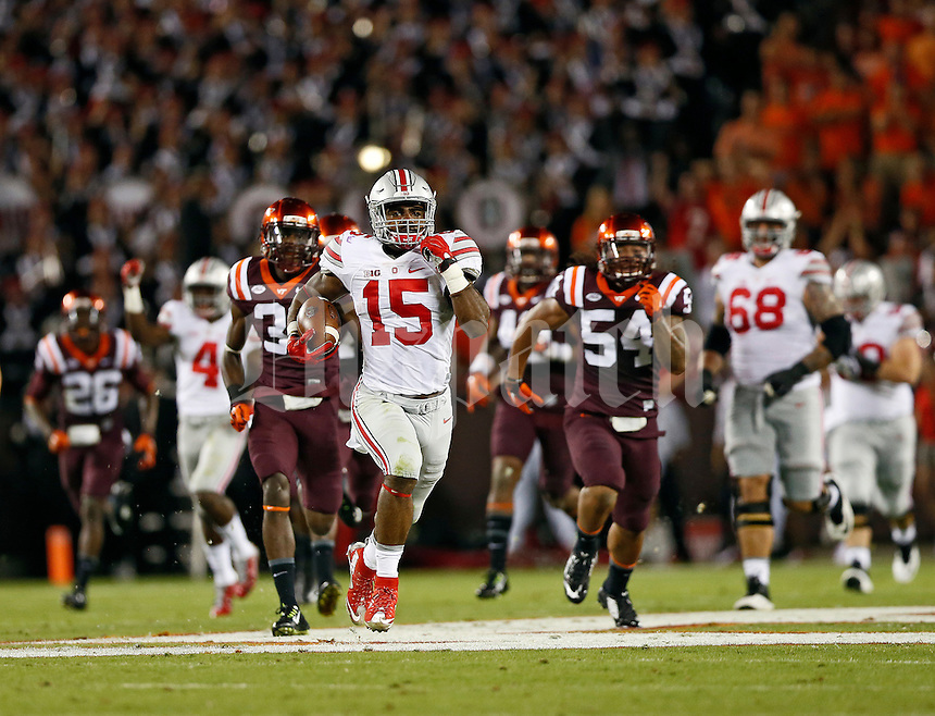 Ohio State Buckeyes running back Ezekiel Elliott (15) runs for an 80-yard touchdown during the NCAA football game against Virginia Tech at Lane Stadium in Blacksburg, Virginia on Sept. 7, 2015. Ohio State won 42-24. (Adam Cairns / The Columbus Dispatch)