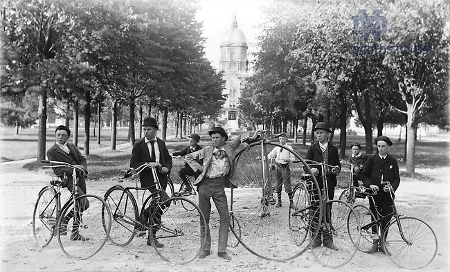 GGPN 14/16:  Minims students with bicycles on Main Quad with Main Building Dome in the background, 1892..Photo by Rev. Alexander Kirsch, CSC..Image from the University of Notre Dame Archives.