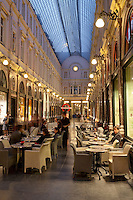 Belgium, Province Brabant, Brussels: Cafe scene in the Saint Hubert Arcades at night