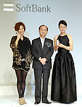 Actresses Aya Ueto, 22 (left), Kanako Higuchi, 50 (right) and KDDI President Masayoshi Son (center) pose with SoftBank?s premium mobile handset SoftBank 823SH Tiffany. Ueto and Higuchi appear in Softbank TV commercials as daughter and mother. The Tiffany model features 537 diamonds?18.34 carats in total. Ten handsets will be sold for 11.298 million yen each. The handset will be displayed at Softbank?s shop in Omotesando from Nov 1 to 9 and Tiffany?s shop in Marunouchi from Nov 1 to 16.