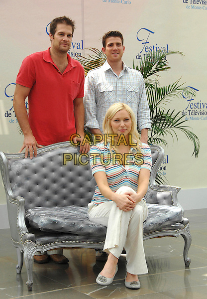 "GEOFF STULTS, LAURA PREPON & BRYAN GREENBERG.attends a photocall promoting the television series ""October Road"" on the third day of the 2008 Monte Carlo Television Festival held at Grimaldi Forum in Monte Carlo, Principality of Monaco, .June 10, 2008..full length red t-shirt cast sitting striped top standing behind sofa.CAP/TTL .©TTL/Capital Pictures"