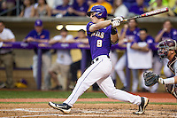 LSU Tigers shortstop Alex Bregman (8) follows through on his swing during a Southeastern Conference baseball game against the Texas A&M Aggies on April 24, 2015 at Alex Box Stadium in Baton Rouge, Louisiana. LSU defeated Texas A&M 9-6. (Andrew Woolley/Four Seam Images)