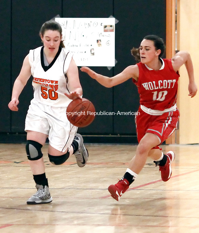 Watertown, CT- 14 February 2013-021413CM03- Watertown's Jamie Zoldy, left, takes the ball up court before Wolcotts' Jessica DeVitto moves in for the steal during their NVL matchup Thursday night in Watertown.   Christopher Massa Republican-American