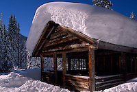 Snow Covered Log Cabin Warming Hut along Cross Country Skiing Trail at Strawberry Flats, Manning Provincial Park, BC, British Columbia, Canada - Southwestern BC Region, Winter