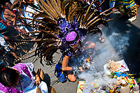 A Mexican indigenous dancer performs an ancient Aztec Death Worship dance during a religious ceremony honoring Santa Muerte (Saint Death) in Tepito, a violent neighborhood of Mexico City, Mexico, 1 May 2011. The religious cult of Santa Muerte is a syncretic fusion of Aztec death worship rituals and Catholic beliefs. Born in lower-class neighborhoods of Mexico City, it has always been closely associated with crime. In the past decades, original Santa Muerte's followers (such as prostitutes, pickpockets and street drug traffickers) have merged with thousands of ordinary Mexican Catholics. The Saint Death veneration, offering a spiritual way out of hardship in the modern society, has rapidly expanded. Although the Catholic Church considers the Santa Muerte's followers as devil worshippers, on the first day of every month, crowds of believers in Saint Death fill the streets of Tepito. Holding skeletal figurines of Holy Death clothed in a long robe, they pray for power healing, protection and favors and make petitions to 'La Santísima Muerte', who reputedly can make life-saving miracles.