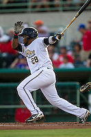 San Antonio Missions outfielder Yeison Asencio (28) follows through on his swing in the Texas League baseball game against the Frisco Roughriders on August 22, 2013 at the Nelson Wolff Stadium in San Antonio, Texas. Frisco defeated San Antonio 2-1. (Andrew Woolley/Four Seam Images)