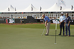 Greg Norman putts while Jeev Milkha Singh and Saeed Harib look on during practice day at the Dubai World Championship in Jumeirah Golf Estates, Dubai  UAE, 17th November 2009 (Photo by Eoin Clarke/GOLFFILE)