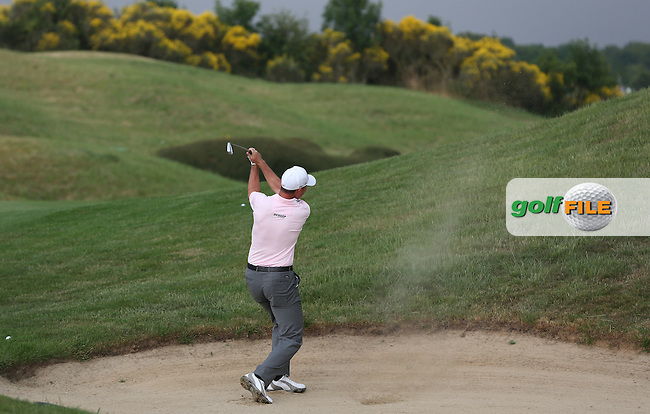 David Howell (ENG) caught in the fairway bunker on the 12th during Round One of the 2015 Alstom Open de France, played at Le Golf National, Saint-Quentin-En-Yvelines, Paris, France. /02/07/2015/. Picture: Golffile   David Lloyd<br /> <br /> All photos usage must carry mandatory copyright credit (&copy; Golffile   David Lloyd)