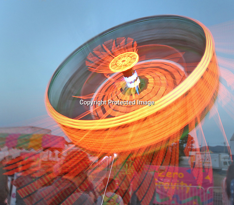 "A ""zero gravity"" ride spinning during the Mill Valley Memorial Day Carnival."