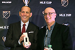 04 December 2015: MLS Commissioner Don Garber (left) honors New York sportswriter Michael Lewis before the press conference for attending all 20 MLS Cups. Major League Soccer held a press conference two days before MLS Cup 2015 between the Portland Timbers FC and Columbus Crew SC. The Press Conference was held at the Greater Columbus Convention Center in Columbus, Ohio.