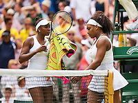 England, London, Juli 06, 2015, Tennis, Wimbledon, De sisters Venus and Serena Williams (USA) playing eachother on centercourt, pictured: Serena (R) passing Venus during changeover<br /> Photo: Tennisimages/Henk Koster