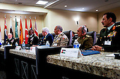 United States President Barack Obama (unseen) speaks after attending a meeting hosted by Joint Chiefs of Staff General Martin E. Dempsey  (L) with the military leadership from 21 coalition partner nations to discuss the coalition efforts in the ongoing campaign against ISIL on October 14, 2014 at Joint Base Andrews in Maryland.  Air Marshal Binskin from Australia (3L), General Yousif from Bahrain, General Gerard Van Caelenberge from Belgium, General Lawson from Canada (2L),  Lieutenant General Ludvigsen from Denmark, Lieutenant General Hegazy from Egypt (3R), General de Villiers from France (L), Lieutenant General Schelzig from Germany,  General Babakir from Iraq (2R), Admiral Binelli-Mantelli from Italy, General Al-Zaben from Jordan (R), Lieutenant General Al-Khadher from Kuwait, Lieutenant General Jean Kahwagi from Lebanon, General Middendorp from Netherlands, Lieutenant General Keating from New Zealand,  General Ghanim from Qatar, General Al-Banyan from Saudi Arabia, Admiral GarcÌa from Sapin, Lieutenant General ?zt¸rk from Turkey, Major General Al Mazrouei from United Arab Emirates, General Sir Nicholas Houghton from United Kingdom and US National Security Advisor Susan Rice,  US Homeland Security Advisor Lisa Monaco and U.S. Central Command General Lloyd Austin III also attended (2L). <br /> Credit: Aude Guerrucci / Pool via CNP