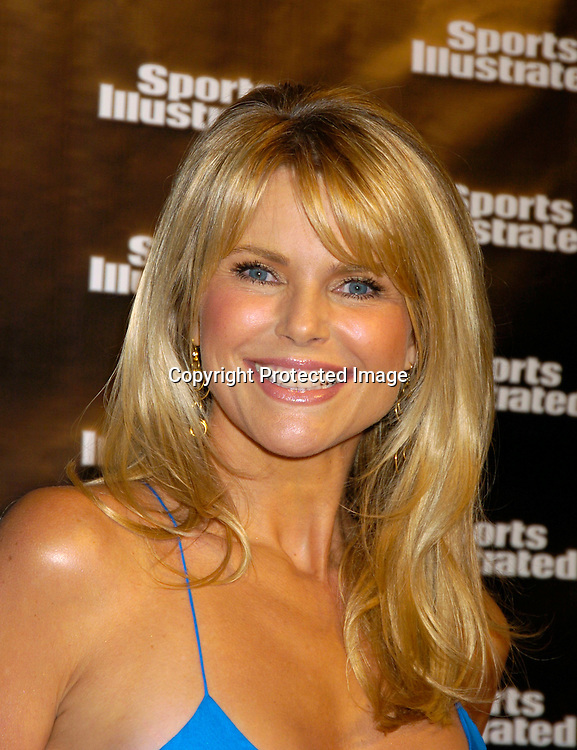 Christie Brinkley in dress by Ralph Lauren..at the 2004 Sports Illustrated Swimsuit Issue Press Event at ..Deep in NYC on Tuesday 10, 2004.                              Photo by Robin Platzer, Twin Images