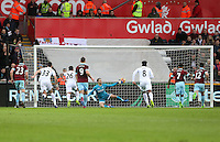 Andre Gray of Burnley scores his sides first goal of the match during the Premier League match between Swansea City and Burnley at The Liberty Stadium, Swansea, Wales, UK. Saturday 06 March 2017