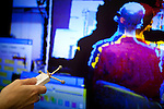 University of California, Davis Assistant Research Scientist Oliver Kreylos demonstrates his use of a hacked Xbox Kinect combined with a hacked Nintendo Wii controller to create a 3D interface in his lab at UC Davis, November 19, 2010.