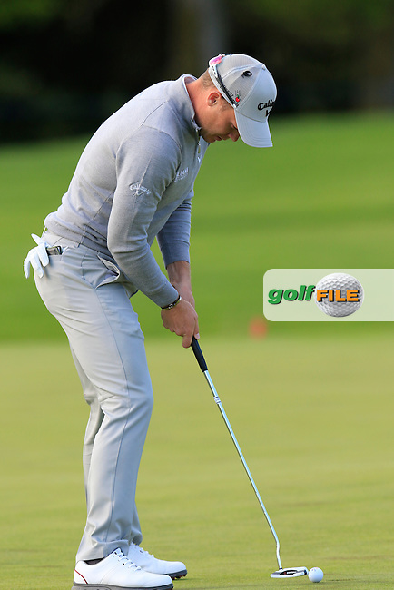 Danny Willett (ENG) taps in for birdie on the 18th green during Thursday's Round 1 of the 2016 Dubai Duty Free Irish Open hosted by Rory Foundation held at the K Club, Straffan, Co.Kildare, Ireland. 19th May 2016.<br /> Picture: Eoin Clarke | Golffile<br /> <br /> <br /> All photos usage must carry mandatory copyright credit (&copy; Golffile | Eoin Clarke)