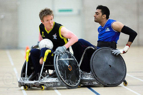 27 MAY 2013 - DONCASTER, GBR - Luke White (left) of Stoke Mandeville Storm avoids a challenge from Mandip Sehmi (right) of Kent Crusaders during the 2013 Great Britain Wheelchair Rugby Nationals final at The Dome in Doncaster, South Yorkshire, Great Britain (PHOTO (C) 2013 NIGEL FARROW)