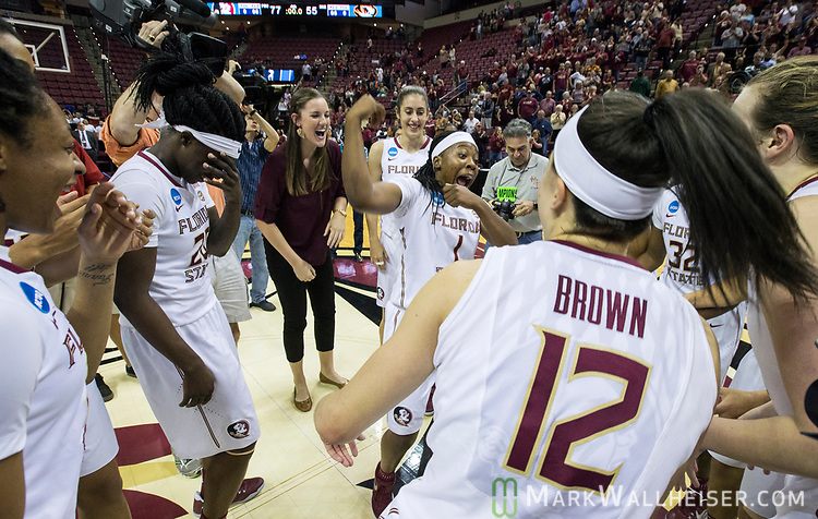 Florida State celebrates mid-court after defeating Missouri 77-55 a second-round game of the NCAA women's college basketball tournament in Tallahassee, Fla., Sunday, March 19, 2017. (AP Photo/Mark Wallheiser)