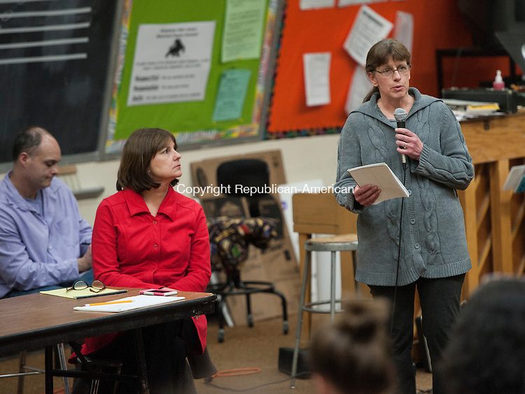 WINSTED, CT-7 April 2015-040715EC01-  Stacy Corbran speaks at a Winchester Board of Education meeting to discuss whether students should have another option outside of The Gilbert School. Corbran has five children who have gone various paths in education, including home schooling, private school znd Gilbert. She is in favor of parental choice. Tuesday night's meeting was at the Pearson School auditorium. Erin Covey Republican-American