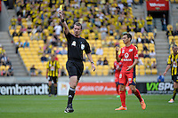 Ref gives a Yellow Card during the A League - Wellington Phoenix v Adelaide United, Wellington, New Zealand on Sunday 30 March 2014. <br /> Photo by Masanori Udagawa. <br /> www.photowellington.photoshelter.com.