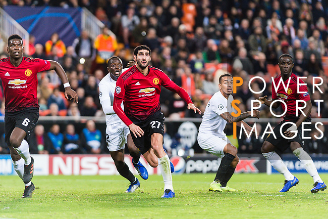 Marouane Fellaini of Manchester United (C) fights for position with Mouctar Diakhaby of Valencia CF (L) during the UEFA Champions League 2018-19 match between Valencia CF and Manchester United at Estadio de Mestalla on December 12 2018 in Valencia, Spain. Photo by Maria Jose Segovia Carmona / Power Sport Images