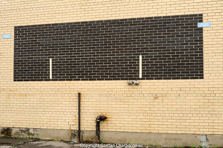 Brick wall and parking space