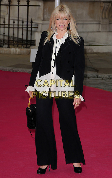 JO WOOD .Royal Academy Summer Exhibition 2010, Royal Academy Of Arts, London, England, UK, June 9th 2010. .full length black jacket white shirt wide leg trousers bag .CAP/CAN.©Can Nguyen/Capital Pictures.