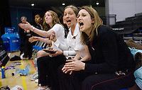 11 MAR 2009 - SHEFFIELD,GBR - Loughborough University coaches Olivia Murphy (second from right) and Kara Luck (right) cheer on the team as they play the University of Bath in the Championship Final at the 2009 BUCS Championships. (PHOTO (C) NIGEL FARROW)