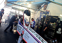 Apr 27, 2014; Baytown, TX, USA; Nitro fumes fill the pit area of NHRA top fuel dragster driver Antron Brown during the Spring Nationals at Royal Purple Raceway. Mandatory Credit: Mark J. Rebilas-