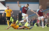 Burnley's Johann Gudmundsson is tackled by Wolverhampton Wanderers' Romain Saiss<br /> <br /> Photographer Rich Linley/CameraSport<br /> <br /> The Premier League - Burnley v Wolverhampton Wanderers - Saturday 30th March 2019 - Turf Moor - Burnley<br /> <br /> World Copyright © 2019 CameraSport. All rights reserved. 43 Linden Ave. Countesthorpe. Leicester. England. LE8 5PG - Tel: +44 (0) 116 277 4147 - admin@camerasport.com - www.camerasport.com