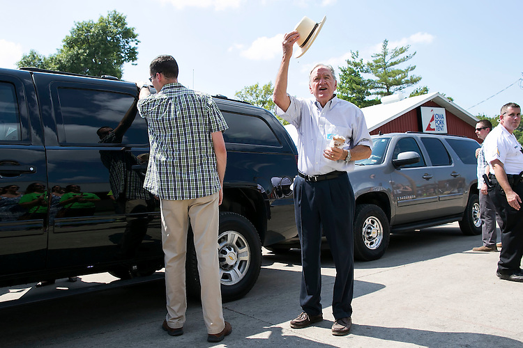 UNITED STATES - August 15: Former U.S. Sen. Tom Harkin greets visitors with his pork chop on a stick as he visits the Iowa State Fair with Democratic presidential candidate Hillary Rodham Clinton in Des Moines, Iowa, on Saturday, August 15, 2015. (Photo By Al Drago/CQ Roll Call)