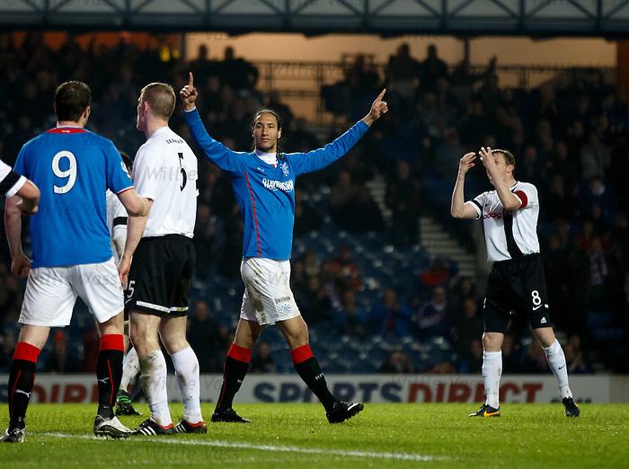 Bilel Mohsni celebrates after opening the scoring for Rangers