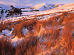 Winter snow in the Lowther Hills looking down on the small village of Durisdeer near sunset Dumfries and Galloway Scotland UK