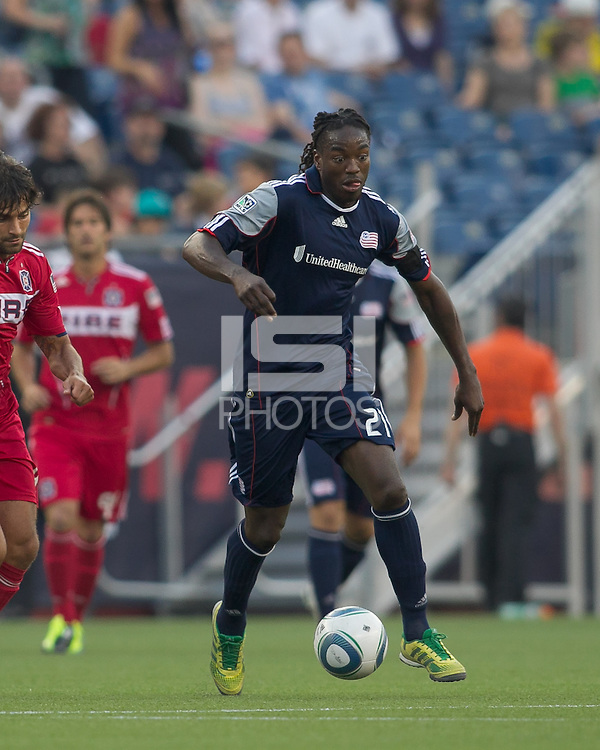 New England Revolution midfielder Shalrie Joseph (21) dribbles at midfield. In a Major League Soccer (MLS) match, the New England Revolution tied the Chicago Fire, 1-1, at Gillette Stadium on June 18, 2011.