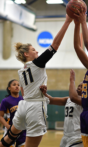 Sarah Pulis #11 of Baldwin, left, tips a ball loose during the Class AA varsity girls basketball Long Island Championship against Central Islip at SUNY Old Westbury on Saturday, March 11, 2017. She grabbed 15 rebounds as Baldwin, who led by one point (31-30) late in the third quarter, used a 22-0 run spanning the third and fourth quarters en route to a 56-31 win.