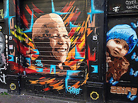 Fresh Nelson Mandela portrait on wall in Spuistraat after his death on 5 December 2013.<br />