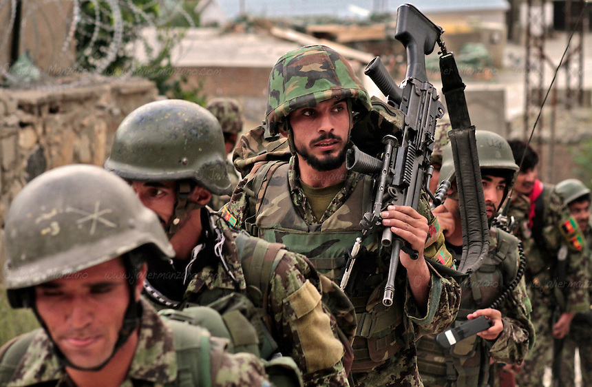 Afghan National Army soldiers depart from Combat Outpost  Nangalam located in the heart of the Pech Valley in Eastern Afghanistan's volatile Kunar province for a 32-hour mission.  ..(PHOTO: Javier Manzano). ..