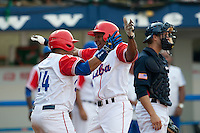 27 September 2009: First base Ariel Borrero of Cuba is congratulated by Frederich Cepeda as he hits a two run home run off pitcher Brad Lincoln to tie the score during the 2009 Baseball World Cup gold medal game won 10-5 by Team USA over Cuba, in Nettuno, Italy.