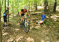 NWA Democrat-Gazette/MICHAEL WOODS &bull; @NWAMICHAELW<br /> Mountain biker Austin Morris leads the pack as he rides the trail during the 19 and under  Mountain Bike Championships at Slaugther Pen in Bentonville Saturday August 8, 2015. The event sponsored by the Bentonville Parks and Recreation Department,  is an exhibition this year as the new National Interscholastic Cycling Association works to set up its local league. It will be a competitive championship event in the future for ages 6-19.