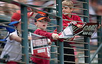 STANFORD, CA - April 23, 2011: Young fans of Stanford baseball wave signs during Stanford's game against UCLA at Sunken Diamond. Stanford won 5-4.