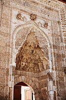 The marble crown gate of Gök Medrese has a very rich decorative appearance. Its islamic Muqarnas corbelled vault is made up of a large number of miniature squinches, producing a sort of cellular structure. The crown gate of Gök Medrese is one of the best examples of Sejuk architecture in Anatolia, Sivas, Turkey