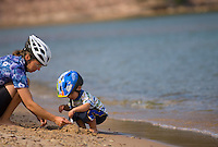 A mother and toddler son explore the North Light beach while mountain biking on Grand Island National Recreation Area in Munising Michigan.