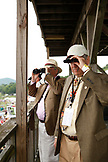 USA, Tennessee, Nashville, Iroquois Steeplechase, men watch the second race through their binoculars