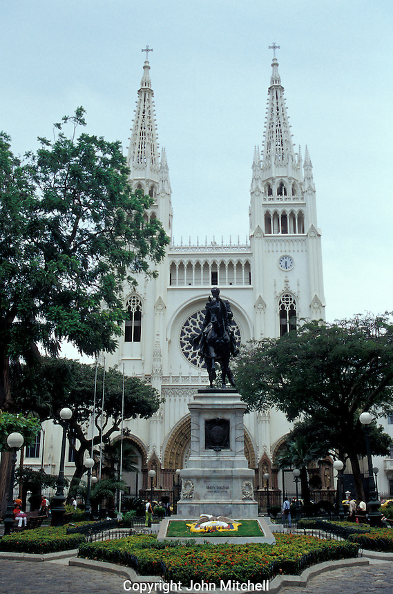 Gothic-style cathedral and equestrian statue of Simon Bolivar in Parque Bolivar, Guayaquil, Ecuador