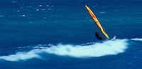 Windsurfer with the Moku lua island off in the distance, the Island of Oahu