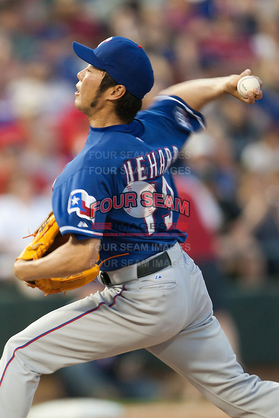 """Texas Rangers pitcher Koji Uehara #19 delivers during the MLB exhibition baseball game against the """"AAA"""" Round Rock Express on April 2, 2012 at the Dell Diamond in Round Rock, Texas. The Rangers out-slugged the Express 10-8. (Andrew Woolley / Four Seam Images)."""