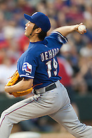 "Texas Rangers pitcher Koji Uehara #19 delivers during the MLB exhibition baseball game against the ""AAA"" Round Rock Express on April 2, 2012 at the Dell Diamond in Round Rock, Texas. The Rangers out-slugged the Express 10-8. (Andrew Woolley / Four Seam Images)."