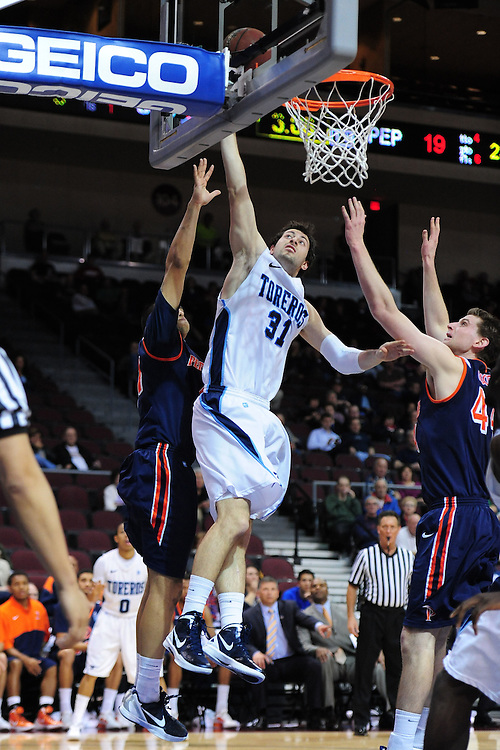 March 1, 2012; Las Vegas, NV, USA; San Diego Toreros guard/forward John Sinis (31) shoots the ball against the Pepperdine Waves during the WCC Basketball Championships at Orleans Arena.
