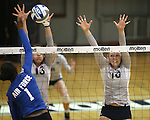 Nevada's Donna Greely (13) and Sam Willouoghby (10) block against Air Force's Akokwe Clement (1) during college volleyball action in Reno, Nev., on Thursday, Sept. 25, 2014. Air Force won 3-2.<br /> Photo by Cathleen Allison