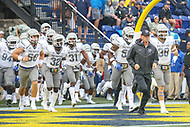 Annapolis, MD - September 8, 2018: Memphis Tigers head coach Mike Norvell leads the Memphis Tigers before the game between Memphis and Navy at  Navy-Marine Corps Memorial Stadium in Annapolis, MD.   (Photo by Elliott Brown/Media Images International)